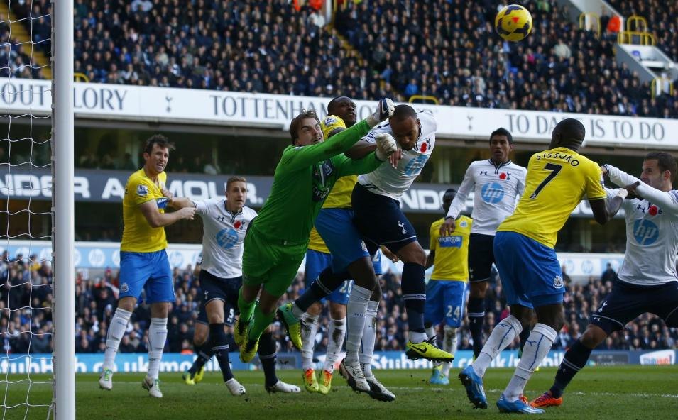 Newcastle United's Krul punches the ball clear from Tottenham Hotspur's Kaboul during their English Premier League soccer match at White Hart Lane in London