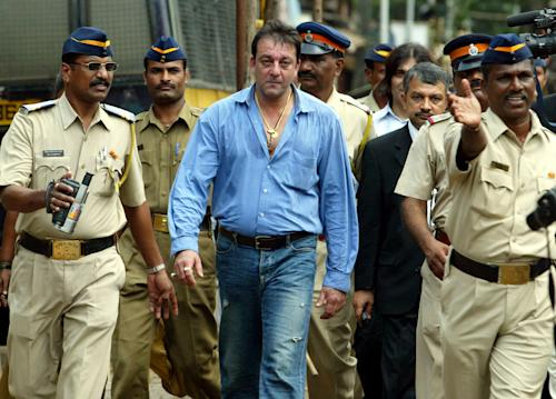 FILE - In this Sept. 12, 2006 file photo, Bollywood actor Sanjay Dutt leaves a special court trying the cases of those accused in the 1993 Mumbai bombings in Mumbai, India. India's Supreme Court has sentenced Dutt to five years in jail for illegal weapons possession in a case linked to the 1993 bombing that killed 257 people in Mumbai. The court on Thursday, March 21, 2013, ordered Dutt to surrender to police within four weeks on the charge of possessing three automatic rifles and a pistol that had been supplied to him by men subsequently convicted in the bombing. (AP Photo/Rajesh Nirgude, File)