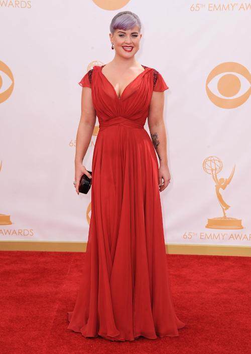 Kelly Osbourne, wearing Jenny Packham, arrives at the 65th Primetime Emmy Awards at Nokia Theatre on Sunday, Sept. 22, 2013, in Los Angeles. (Photo by Jordan Strauss/Invision/AP)