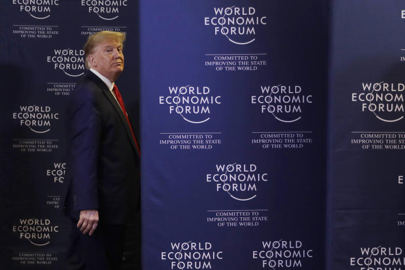 FILE - In this Jan. 22, 2020, file photo, President Donald Trump leaves after a news conference at the World Economic Forum in Davos, Switzerland. It's been a week packed with rhetoric from President Donald Trump. This, as his Senate impeachment trial unfolded and the economic forum in Davos, Switzerland, played out. An AP Fact Check put his statements under scrutiny and found distortions on a range of topics. (AP Photo/Evan Vucci, File)