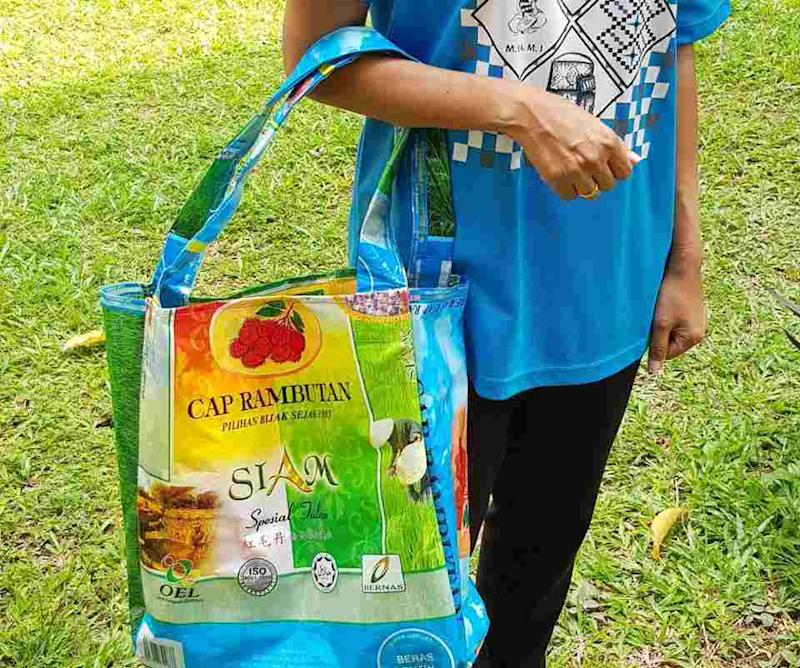 Instead of sending empty rice bags to the landfill, why not recycle them to become a grocery bags made by Orang Asli women at Labu, Negeri Sembilan. — Picture courtesy of Carrol Lawrence