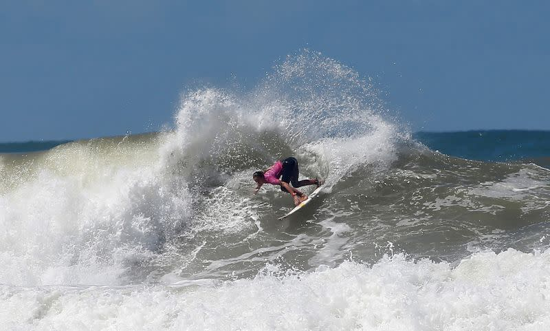 FILE PHOTO: French surfer Justine Dupont rides her wave at Casablanca Beach during the Quiksilver and Roxy Pro Casablanca surfing competition in Casablanca