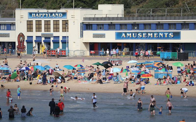 People enjoy the hot weather at Bournemouth beach in Dorset - PA