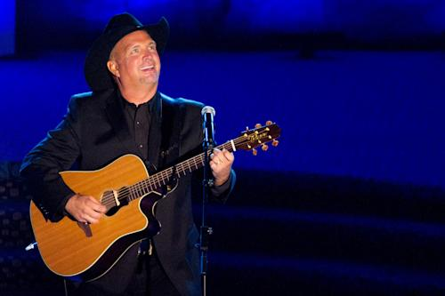 FILE - This June 16, 2011 file photo shows inductee Garth Brooks performs onstage at the 42nd Annual Songwriters Hall of Fame Awards in New York. Brooks will play six more dates this fall at Wynn Las Vegas, concluding the three-year run Nov. 16-17. Brooks edged slightly out of retirement to take the gig in 2009. It came with the gift of a jet from Steve Wynn. (AP Photo/Charles Sykes, file)