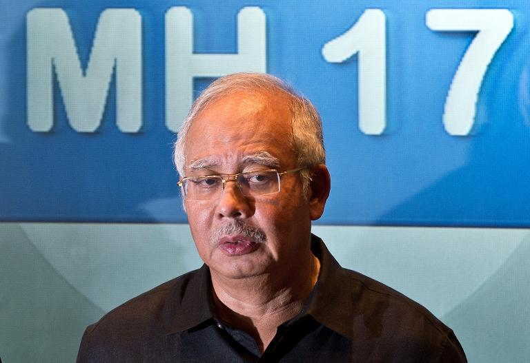 Malaysian Prime Minister Najib Razak addresses a press conference at a hotel in Sepang, ouside Kuala Lumpur, on July 18, 2014