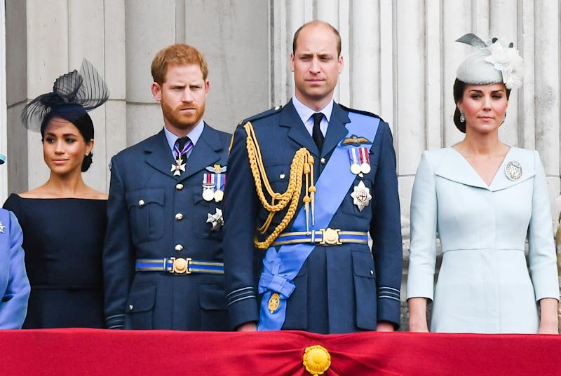 LONDON, UNITED KINGDOM - JULY 1O: Meghan, Duchess of Sussex, Prince Harry, Duke of Sussex, Prince William, Duke of Cambridge and Catherine, Duchess of Cambridge stand on the balcony of Buckingham Palace to view a flypast to mark the centenary of the Royal Air Force (RAF) on July 10, 2018 in London, England. (Photo by Anwar Hussein/WireImage)