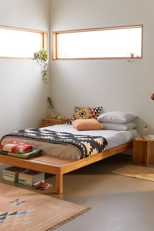 "<p>You can store stuff underneath this <a href=""https://www.popsugar.com/buy/Lita-Bed-559542?p_name=Lita%20Bed&retailer=urbanoutfitters.com&pid=559542&price=599&evar1=casa%3Aus&evar9=46000214&evar98=https%3A%2F%2Fwww.popsugar.com%2Fhome%2Fphoto-gallery%2F46000214%2Fimage%2F47334652%2FLita-Bed&list1=shopping%2Cfurniture%2Corganization%2Cbeds%2Cbedrooms%2Csmall%20space%20living%2Chome%20shopping&prop13=api&pdata=1"" rel=""nofollow"" data-shoppable-link=""1"" target=""_blank"" class=""ga-track"" data-ga-category=""Related"" data-ga-label=""https://www.urbanoutfitters.com/shop/lita-bed?category=SEARCHRESULTS&amp;color=020&amp;searchparams=q%3Dbed%2520frame&amp;type=REGULAR&amp;size=QUEEN&amp;quantity=1"" data-ga-action=""In-Line Links"">Lita Bed</a> ($599, originally $799) and on the end.</p>"