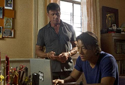 "This film image released by Warner Bros. Pictures shows Sylvester Stallone, left, and Sung Kang in a scene from ""Bullet to the Head."" (AP Photo/Warner Bros. Pictures, Frank Masi)"