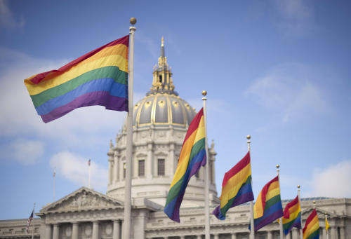 Rainbow flags fly in front of San Francisco City Hall on Wednesday, June 26, 2013, shortly after the U.S. Supreme Court decision that cleared the way for same-sex marriage in California. The justices issued two 5-4 rulings in their final session of the term. One decision wiped away part of a federal anti-gay marriage law that has kept legally married same-sex couples from receiving tax, health and pension benefits. The other was a technical legal ruling that said nothing at all about same-sex marriage, but left in place a trial court's declaration that California's Proposition 8 is unconstitutional. (AP Photo/Noah Berger)