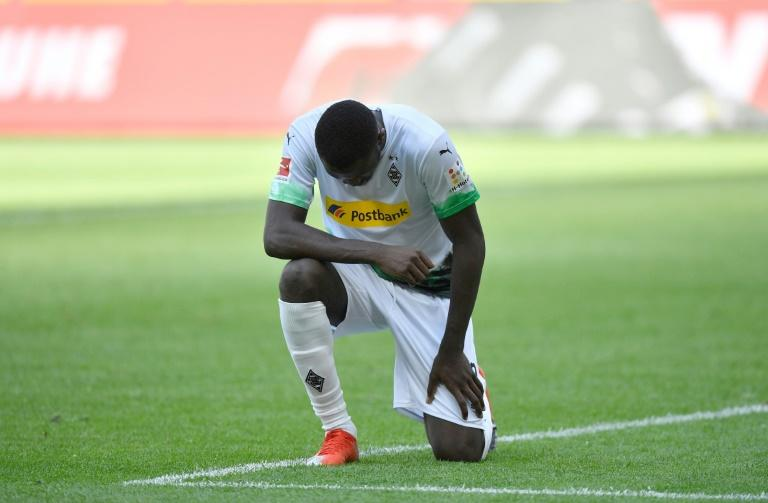 Marcus Thuram took a knee after scoring for Borussia Moenchengladbach sparking action in support from his club