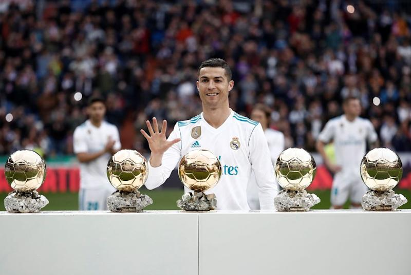 Cristiano Ronaldo poses with his five Golden Ball (Ballon d'Or) trophies in 2017 when he was playing for Real Madrid. (Photo by Burak Akbulut/Anadolu Agency/Getty Images)