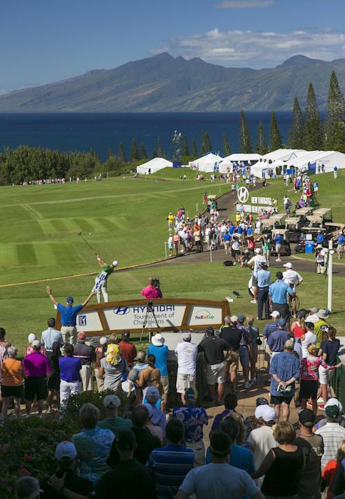 Adam Scott, of Australia, tees off on the first tee during the third round of the Tournament of Champions golf tournament, Sunday, Jan. 5, 2014, in Kapalua, Hawaii. (AP Photo/Marco Garcia)