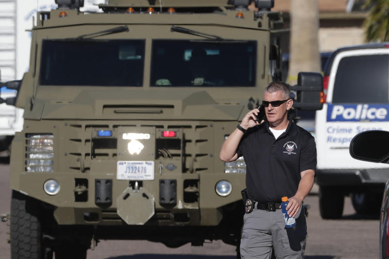 An FBI armored vehicle leaves the scene of a deadly shooting early Monday, March 30, 2020, in Phoenix. Phoenix police say one of their commanders was killed and two other officers were wounded as they responded to a domestic dispute. Authorities say Cmdr. Greg Carnicle and officers were called to a home in the northern part of Phoenix Sunday night over a roommate dispute when the suspect refused to cooperate and shot them. The suspect was not identified and was pronounced dead at the scene. (AP Photo/Matt York)