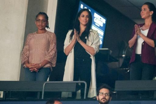 Meghan Markle is likely to be walked down the aisle with her mother Doria Ragland, seen here to her left