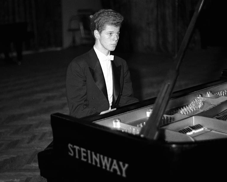 FILE - This April 11, 1958 file photo shows pianist Van Cliburn performing in final round of Tchaikovsky International Piano & Violin competition in Moscow.  Cliburn, the internationally celebrated pianist whose triumph at a 1958 Moscow competition helped thaw the Cold War and launched a spectacular career that made him the rare classical musician to enjoy rock star status  died early Wednesday, Feb. 27, 2013, at his Fort Worth home following a battle with bone cancer.  He was 78. (AP Photo, file)