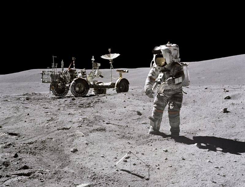 Astronaut John Young and lunar rover