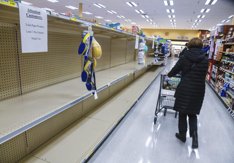 Rosauers customers found the shelves empty of toilet paper during senior and at-risk shopping at the grocery store on 29th Avenue, Thursday, March 19, 2020, in Spokane, Wash. (Dan Pelle/The Spokesman-Review via AP)