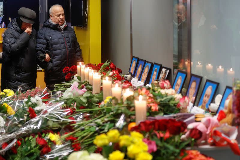 Relatives of the flight crew members of the Ukraine International Airlines Boeing 737-800 plane that crashed in Iran, mourn at a memorial at the Boryspil International airport
