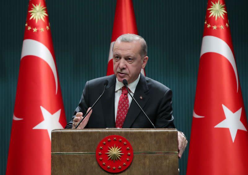 Turkish President Erdogan speaks during a news conference in Ankara