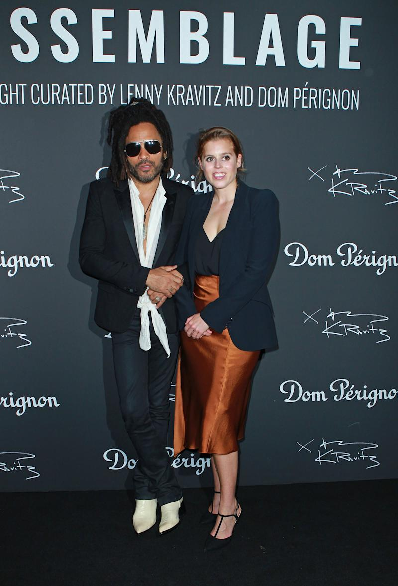 The couple were joined by rocker Lenny Kravitz who was hosting the exibition. Photo: Getty