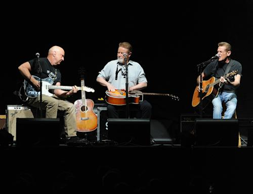 Musicians Bernie Leadon, left, Don Henley and Glenn Frey, right, of the Eagles perform at Madison Square Garden on Friday, Nov. 8, 2013 in New York. (Photo by Evan Agostini/Invision/AP)