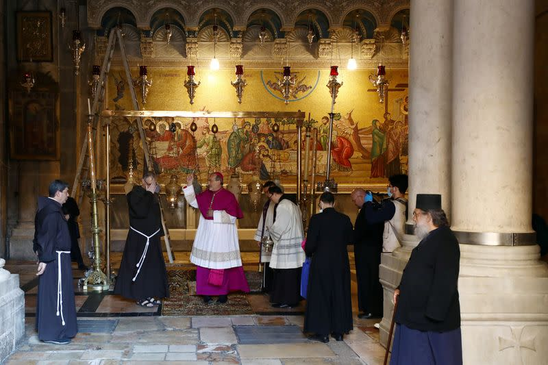 FILE PHOTO: Archbishop Pierbattista Pizzaballa, apostolic administrator of the Latin Patriarchate of Jerusalem stands inside the Church of the Holy Sepulchre amid coronavirus restrictions in Jerusalem's Old City