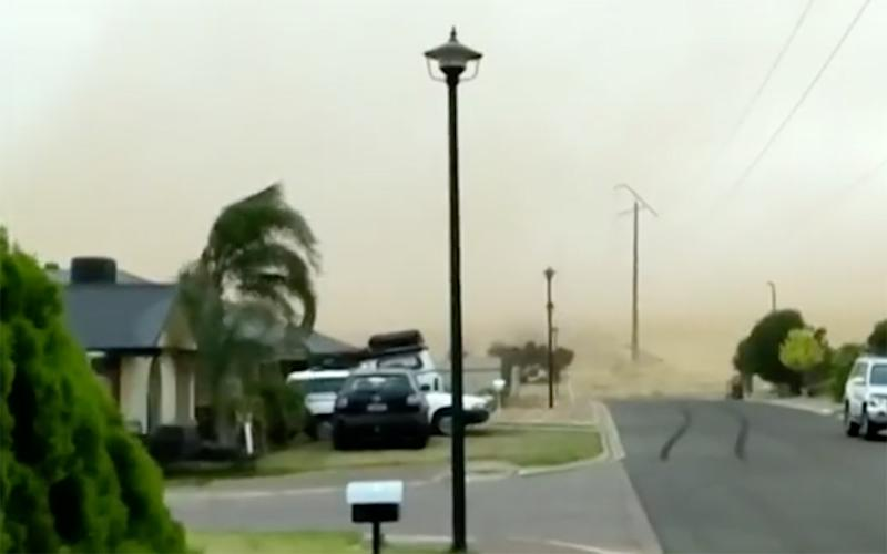 A wall of dust was pushed towards homes from dry paddocks