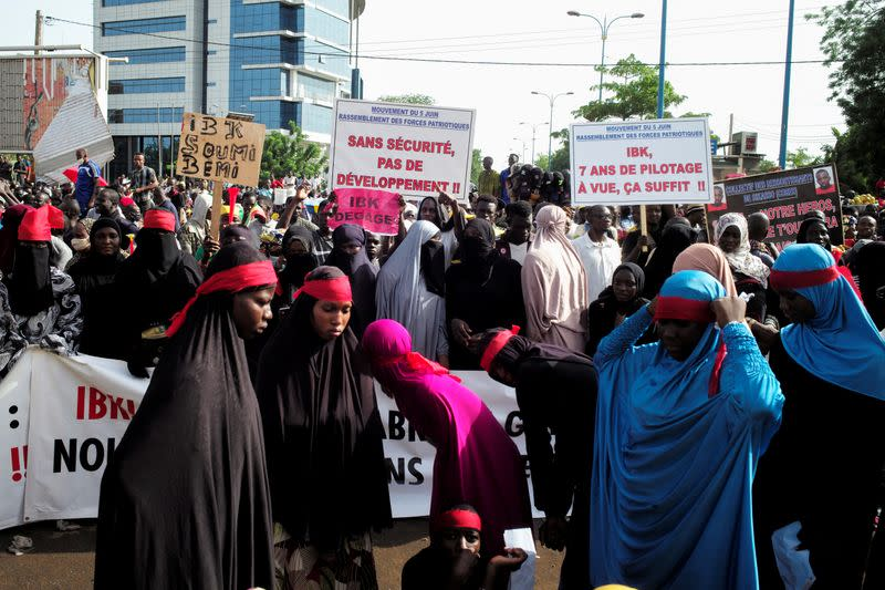 Supporters of the Imam Mahmoud Dicko attend a protest demanding the resignation of Mali's President Ibrahim Boubacar Keita at Independence Square in Bamako