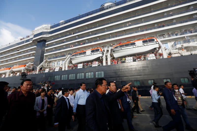 Cambodia's Prime Minister Hun Sen welcomes passenger of MS Westerdam, a cruise ship that spent two weeks at sea after being turned away by five countries over fears that someone aboard might have the coronavirus, as it docks in Sihanoukville