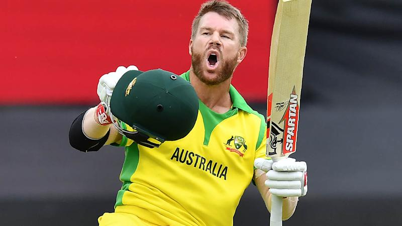 David Warner celebrates after scoring a century. (Photo by SAEED KHAN/AFP/Getty Images)