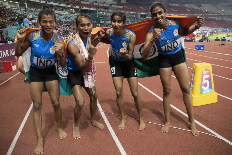 JAKARTA, INDONESIA - AUGUST 30: The India team of celebrate the final of the women's 4*400m athletics event during on day twelve of the Asian Games on August 30, 2018 in Jakarta, Indonesia. (Photo by Fred Lee/Getty Images)