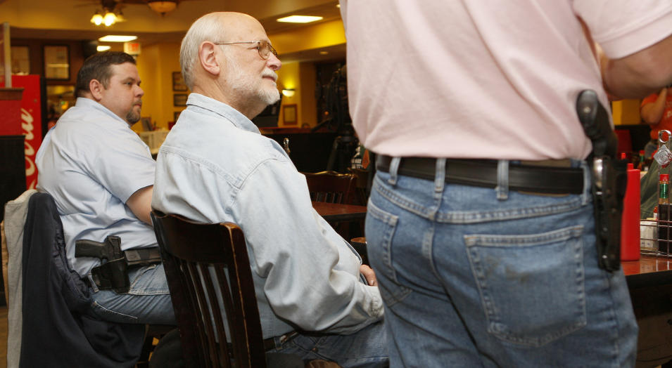 Hull, founding director of OKOCA, addresses members gathered at Beverly's Pancake House in Oklahoma City
