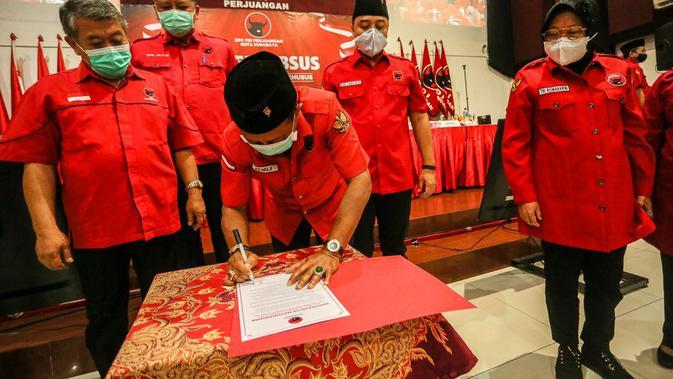 Eri Cahyadi dan Tri Rismaharini dalam Rapat Kerja Cabang Khusus (Rakercabsus) DPC PDIP Surabaya. (Dokumentasi: PDIP).