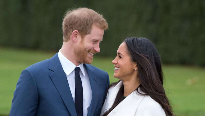 LONDON, ENGLAND - NOVEMBER 27: Prince Harry and Meghan Markle, wearing a white belted coat by Canadian brand Line The Label, attend a photocall in the Sunken Gardens at Kensington Palace following the announcement of their engagement on November 27, 2017 in London, England. (Photo by Anwar Hussein/Getty Images)