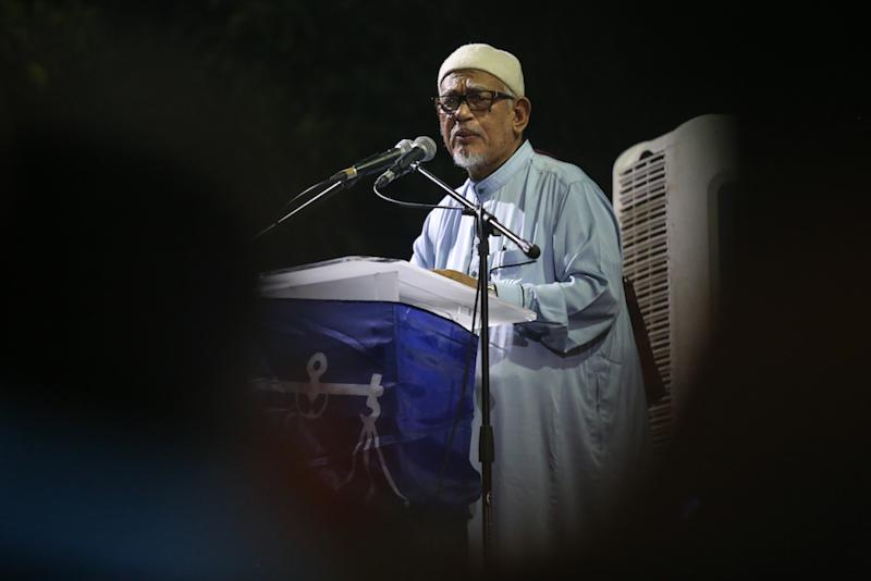 Hadi reminded PAS members of Islamic laws that advise against defamation and told them not to share the sex video of the two men, one said to be a federal minister. — Picture by Ahmad Zamzahuri