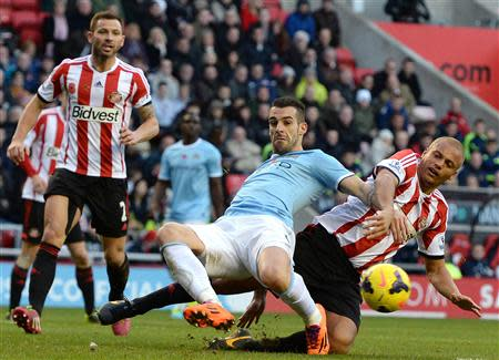 Manchester City's Negredo is challenged by Sunderland's Brown during their English Premier League soccer match in Sunderland