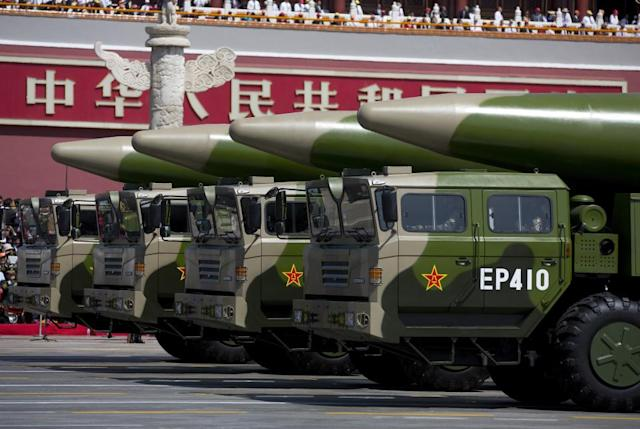 ​​​​​​​Military vehicles carrying DF-26 ballistic missiles, drive past the Tiananmen Gate during a military parade to mark the 70th anniversary of the end of World War Two on September 3, 2015 in Beijing, China. Military analysts have warned that China's new hypersonic ballistic missile could destroy U.S. defense systems. Getty