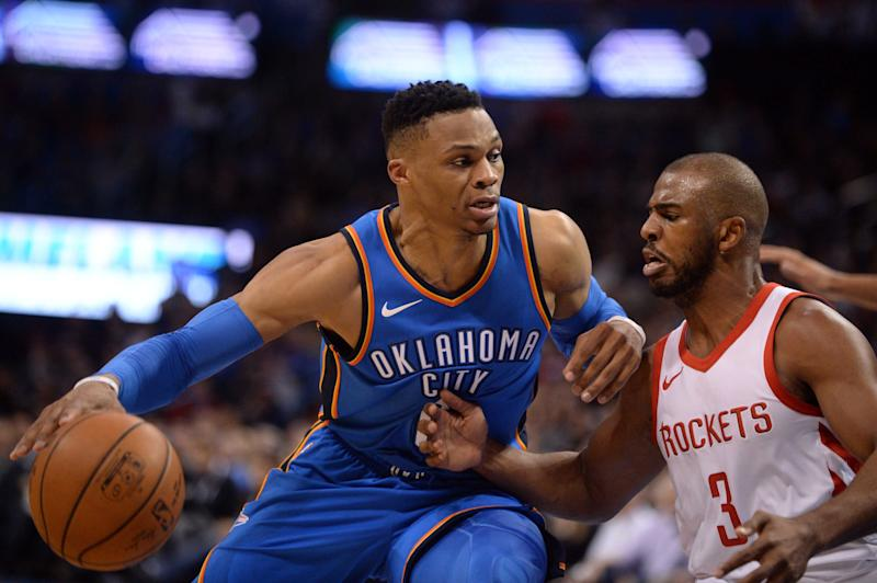 Russell Westbrook and Chris Paul are at the center of a reported NBA blockbuster deal. (Reuters)