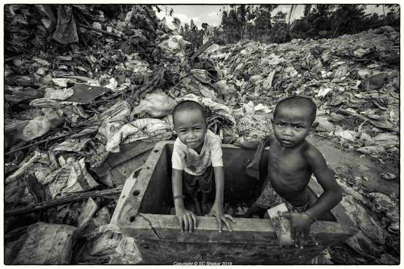 Orang Asli children are seen playing in the landfill. ― Picture by SC Shekar