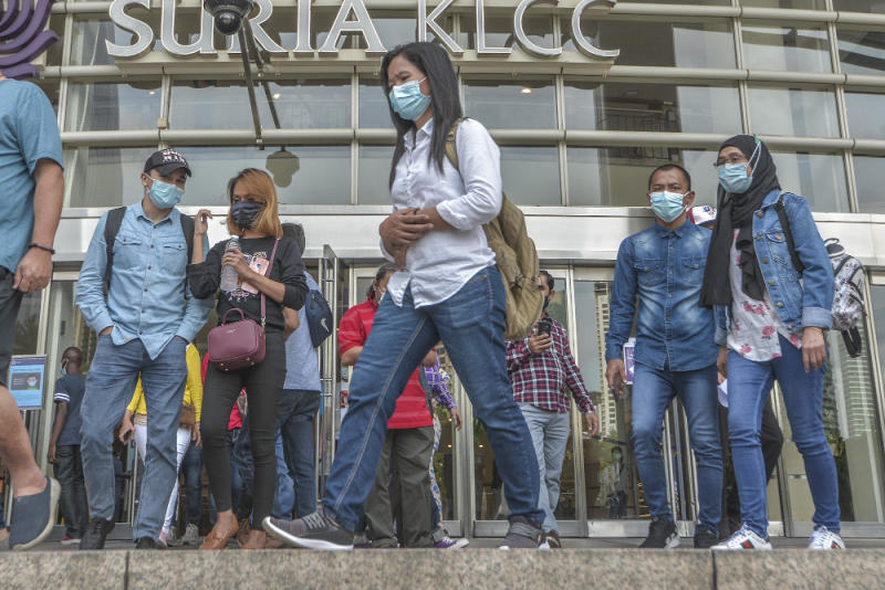Pedestrians wearing face masks at a public area in Kuala Lumpur August 1, 2020. — Picture by Shafwan Zaidon