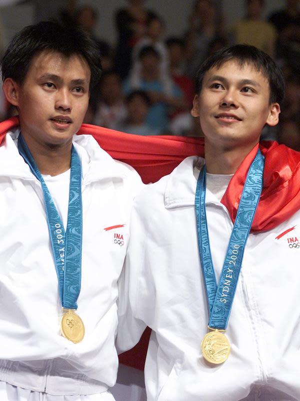 Candra Wijaya dan Tony Gunawan (kanan), juara ganda putra Olimpiade Sydney 2000. (AFP/Robyn Beck)