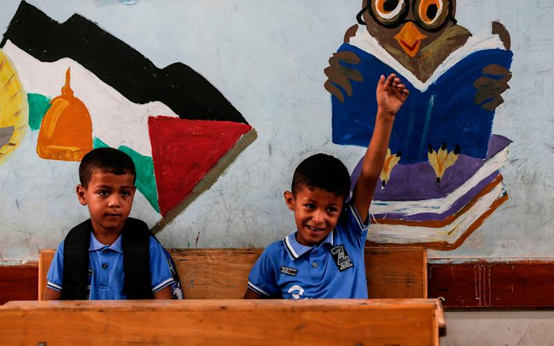 Palestinian students attend a class at a school run by the United Nations Relief and Works Agency in Jabalia refugee camp in northern Gaza Strip - MAHMUD HAMS / AFP
