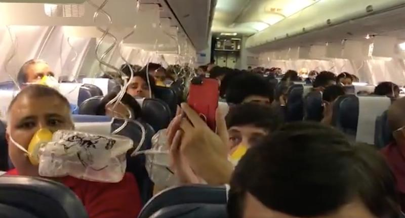 Passengers grab oxygen masks onboard the Jet Airways flight flying in India. Source: Twitter/ Darshak Hathi