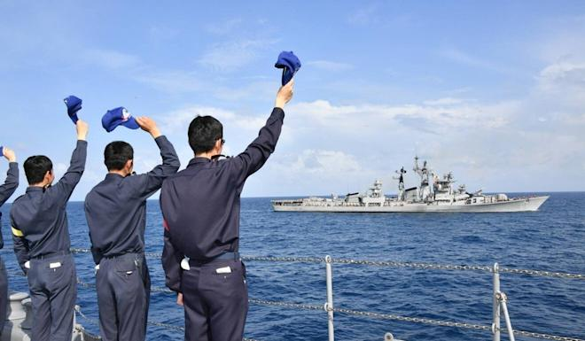 Japanese sailors greet their Indian counterparts during a joint exercise. Photo: Twitter