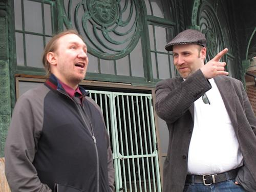 In this May 9, 2012 photo, Christian McKnight, left, senior talent buyer for concert promoter Live nation, discusses the upcoming Bamboozle Festival with Scott O'Donnell, the company's executive director of programming and festivals, in front of the old Carousel building in Asbury Park, N.J. The May 18-20 festival will be headlined by Bon Jovi. (AP Photo/Wayne Parry)
