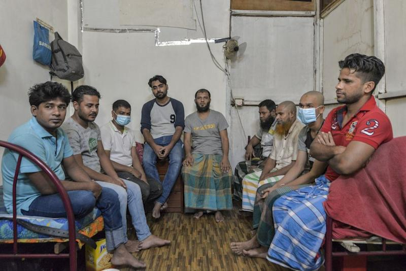Shohel (fourth from left) and his eight housemates. All of them were fasting but insisted on serving us tea. — Picture by Shafwan Zaidon