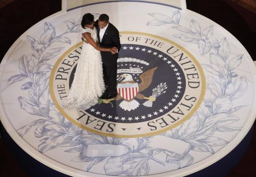 FILE - In this Jan. 20, 2009, file photo, President Barack Obama and first lady Michelle Obama dance at the Commander in Chief Inaugural Ball at the National Building Museum in Washington. Obama's second inauguration is shaping up as a high-energy celebration smaller than his first milestone swearing-in, yet still designed to mark his unprecedented role in American history with plenty of eye-catching glamour. A long list of celebrity performers will give the once-every-four years right of democratic passage the air of a star-studded concert, from the bunting-draped Capitol's west front of the Capitol, where Obama takes the oath Jan. 21, to the Washington Convention Center, which is expected to be packed with 40,000 ball-goers that evening. (AP Photo/Charles Dharapak, File)