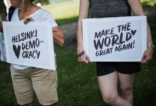 """In the Finnish capital, protesters gathered for the """"Helsinki Calling"""" march for human rights, freedom of speech and democracy ahead of Monday's Trump-Putin summit"""