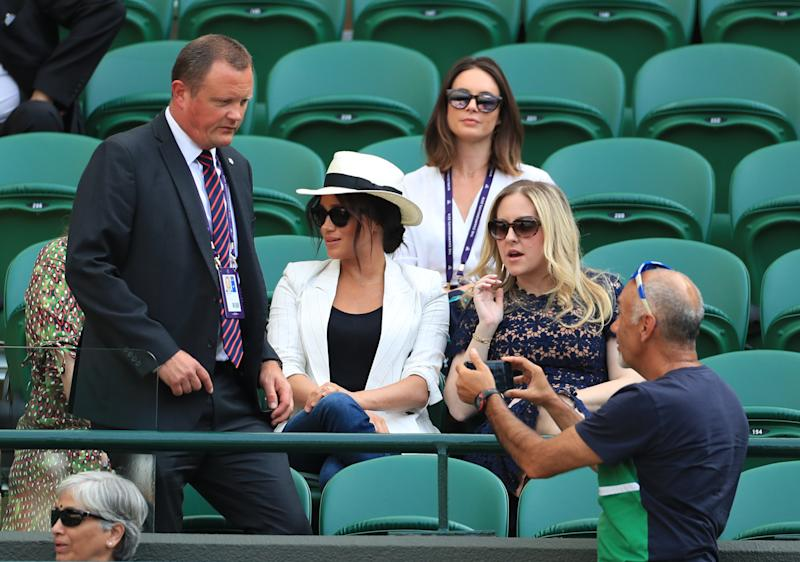 A similar situation unfolded very differently at Wimbledon when Meghan Markle's security detail reprimanded selfie-taker Hasan Hasanov. Photo: Getty Images