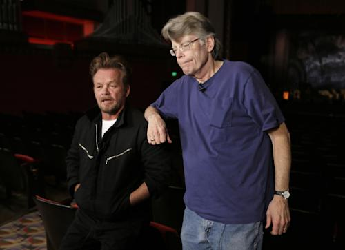 "This Tuesday, Oct. 8, 2013 photo shows musician John Mellencamp, left, and writer Stephen King at a press preview of the musical ""Ghost Brothers of Darkland County"" at the Indiana University Auditorium in Bloomington, Ind. The musical by Mellencamp, King and T Bone Burnett will debut in Bloomington on Thursday before embarking on a tour of 20 U.S. cities. (AP Photo/Michael Conroy)"
